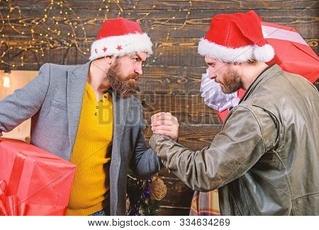 Bearded Men Carry Present Boxes. Brutal Hipster Guys Celebrate Christmas With Gifts. Delivery Christ