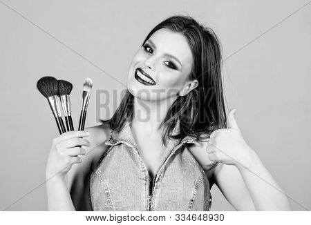 Woman Applying Makeup Brush. Professional Makeup Supplies. Different Brushes. Makeup Cosmetics Conce