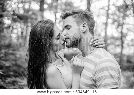 Couple In Love Kissing With Passion Outdoors. Man And Woman Attractive Lovers Romantic Kiss. Passion