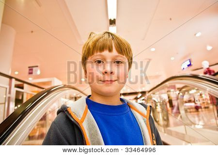 Child On Moving Staircase Looks Self Confident