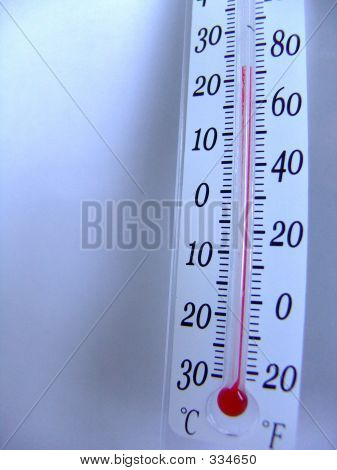 a thermometer is showing a very comfortable room temperature for indoor activities. the shadow depth of field is focusing on the 72 f mark. poster
