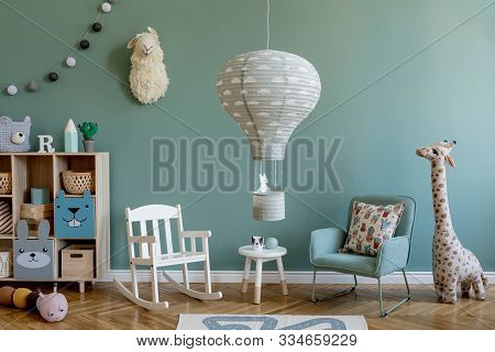 Scandinavian Interior Design Of Playroom With Wooden Cabinet, Armchairs, A Lot Of Plush And Wooden T