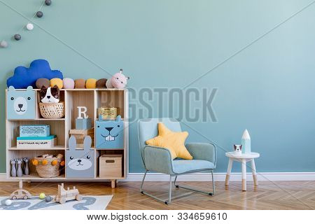 Scandinavian Nursery Room With Wooden Cabinet, Mint Armchair, Natural Teddy Bears And Plush Animal T