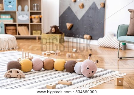 Stylish Scandinavian Newborn Baby Room With Toys, Children Armchair, Teddy Bear , Soft Toys And Desi