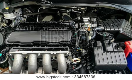 Car Engine Service Concept - Close Up New Car Engine Room On Checking Engine Maintenance Service In