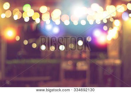 Blurred Bokeh Night Lights In Restaurant, Pub Or Bar, Abstract Image Of Night Festival, Christmas Li