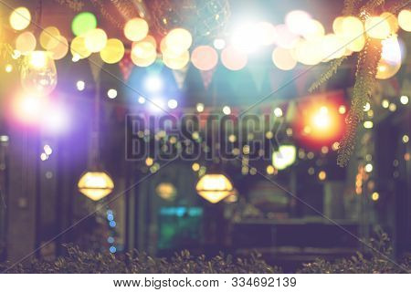 Blurred Bokeh Night Lights In Restaurant, Pub Or Bar, Abstract Image Of Night Festival, Christmas An