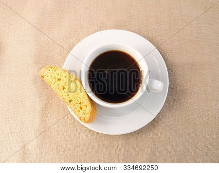 A Cup Of Coffee With Biscotti Biscuits. A Cup Of Coffee With A Traditional Tuscan Biscotti Biscuits.