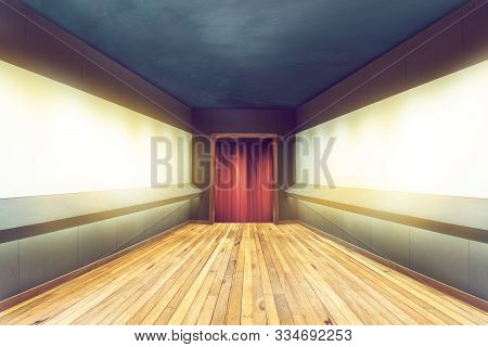 Empty Hallway Of Room With Wooden Floor And Blank Frame On The Wall And A Red Curtain At The Door, R
