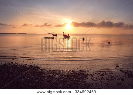 Small Motor Fishing Boat Of The Island Villagers For Tourists Mooring Along At The Beach In Sunrise,