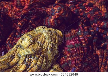 Close Up Of Red And Yellow Colour Tie Dye Silk Yarn For Weaving, Thai Mudmee Fabric, Silk Yarn Dyed