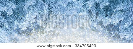 Beautiful Fir Tree Covered Snow And Rime, Closeup. Christmas Panoramic Background With Sparkles, Cop