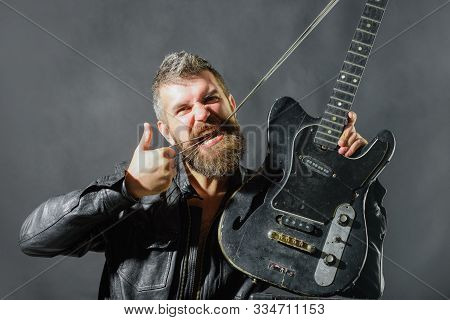 Music Party. Handsome Rock Star In Leather Jacket. Music Concept. Bearded Man With Electric Guitar.