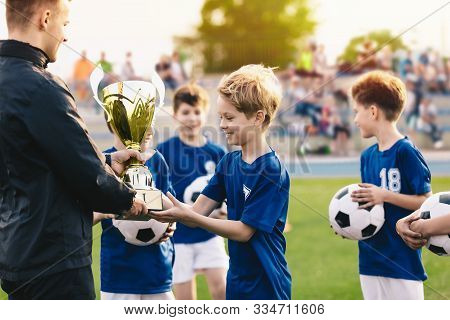Happy Smiling Young Boys Celebrating Sports Soccer Football Championship. Team Winning Football Tour