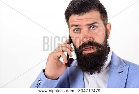 Handsome Man Talking At Cell Phone. Surprised Businessman Calling With Telephone. Businessman Talkin