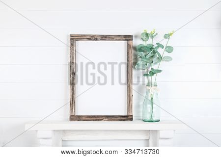 Mock Up Of A Rough Wooden Frame On A White Wall Background In The Interior - Empty Mock Up Frame Wit