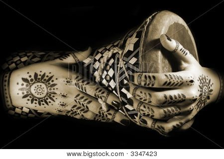 Hands With Oriental Tattoo And Drum