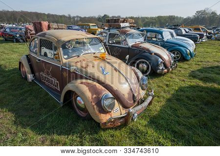 Rushmoor, Uk - April 19: Line Of Vintage Volkswagen Beetle Cars At A Meeting Of Classic Vehicles In