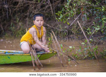 Luang Prabang , Laos - Aug 12 : Laotian Fisherman At The Mekong River In Luang Prabang Laos On Augus