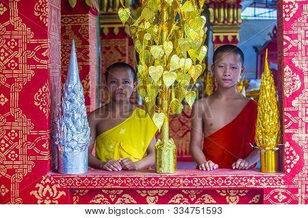 Luang Prabang , Laos - Aug 12 2018 : Novice Monks In Luang Prabang Laos On August 12 2018. It Is Est