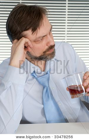 Problems Businessman Sitting At A Table With A Bottle