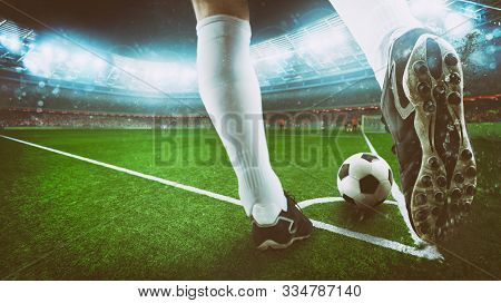 Football Scene At Night Match With Close Up Of A Soccer Shoe Hitting The Ball From Corner Kick