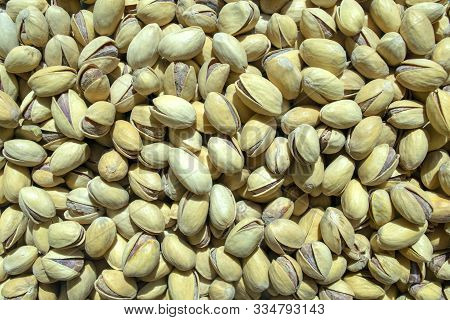 Background Made Of Pistachios Nuts. Healthy Snack And Food. Top View. Nuts. Pistachios