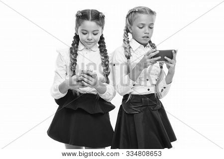 Generation Of Mobile Communication. Little Pupils Using Mobile Devices Isolated On White. Small Scho