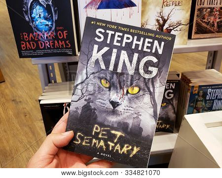 Montreal, Canada - October 23, 2019: A Hand Holding A Stephen King Book Pet Sematary. Stephen King I