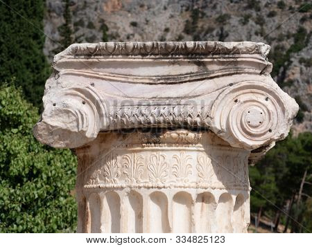 Close Up Of The Intricately Carved Capital Of A Doric Column At Delphi In Greece.