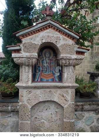Meteora, Greece - September 23, 2019: Close Up Of A Stone Monument With A Painted Icon. Photographed