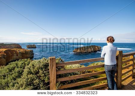 Young Woman Enjoying The View Of Bay Of Martyrs. Tourist Attraction On The Great Ocean Road. Travel