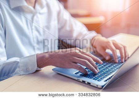 Businessman Hand Using Laptop Computer In Office.