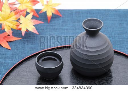 Japanese Traditional Sake Cup And Bottle On Tray