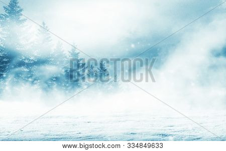 Dark Winter Forest Background At Night. Snow, Fog, Moonlight. Neon Figure In The Center