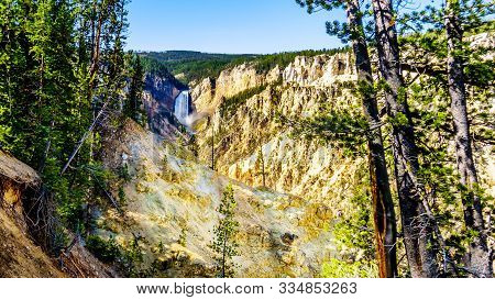 The Upper Falls Of The Yellowstone River As The River Flows Through The Yellow And Orange Sandstone
