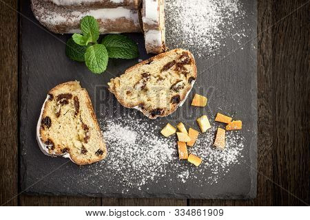 Fruit Cake Sprinkled With Vanilla Sugar, Delicious Fruitcake On Rustic Plate