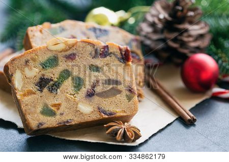 Sweet Christmas Fruit Cake Slices On Brown Paper Put On Black Granite Table In Side View Close Up Wi