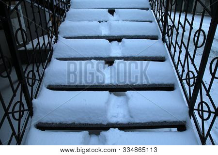 Traces In The Snow. Stairs Under The Snow After The Night Snowfall. Snowy, Fierce And Frosty Winter