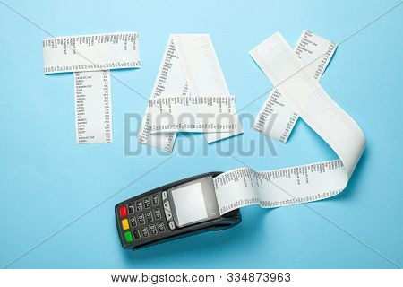 Tax From Paper Bill And Pos Terminal For Payment On Blue Background