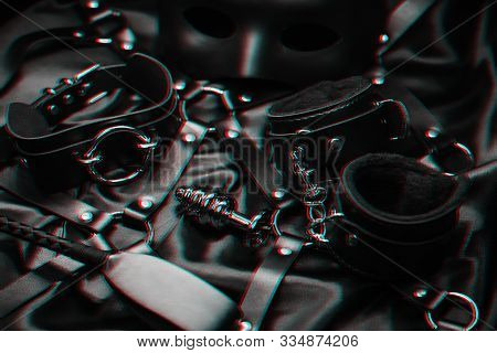 metal anal plug, handcuffs, whip, choker and mask for role-playing erotic games poster