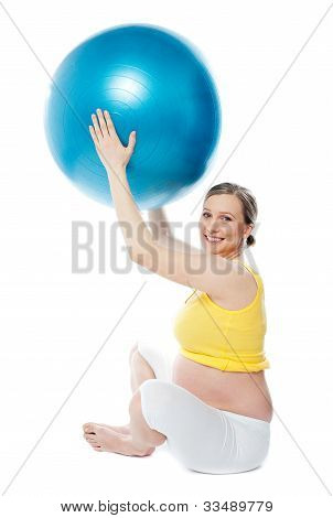 Smiling Pregnant Woman With A Ball