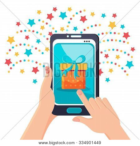 Hand Holding A Modern Smartphone With A Gift On The Screen. Win Via The Mobile App. Notification Of
