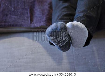 Candid Sort Of Kid Wearing Mismash Sock Sitting On Sofa, Low View Of School Children Hanging Legs We