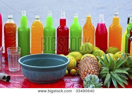 Colorful Fresh Fruit Drinks Are Sold On The Street With Fruits In Front