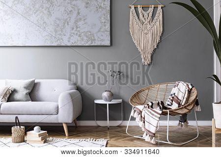 Modern Boho Interior Design Of Sitting Room With Design Rattan Armchair, Gray Sofa, Coffee Table, Be