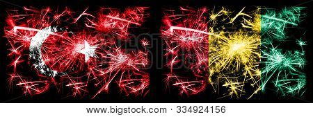 Turkey, Turkish Vs Guinea, Guinean New Year Celebration Sparkling Fireworks Flags Concept Background
