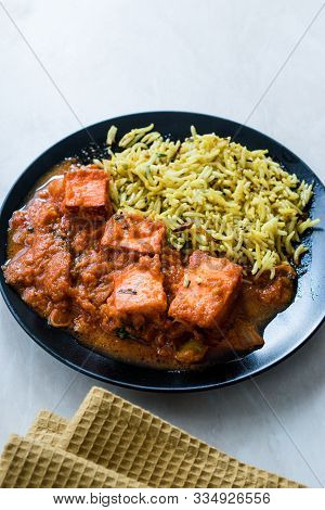 Indian Food Paneer Butter Tikka Masala / Cheese Cottage Curry And Jeera Zira Rice Basmati Pilaf Or P