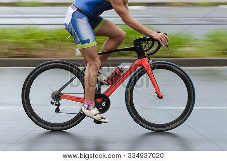 Blurred Image Of A Cyclist In Motion, Picture Shot With The Wiring