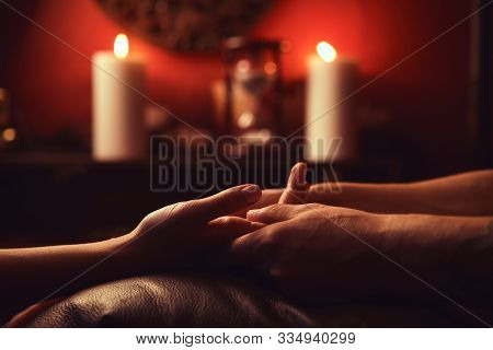 A Man Makes A Woman Acupressure Fingers. Hand Massage With Intimate Lighting. Prelude Before Making